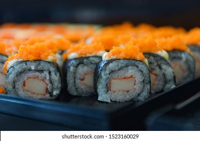 Japanese food sushi roll rice crab stick with Tobiko egg is orange (flying fish roe) nori in the restaurant sushi menu set Japanese cuisine fresh ingredients on tray , selective focus