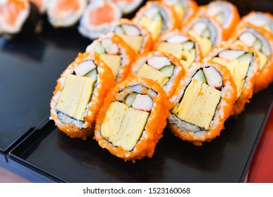 Japanese food sushi roll rice crab stick omelet with Tobiko egg is orange (flying fish roe) nori in the restaurant sushi menu set Japanese cuisine fresh ingredients on tray , selective focus