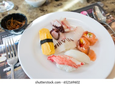 Japanese food, Sushi with variety of flavour, egg, crab, squid and salmon on a white plate