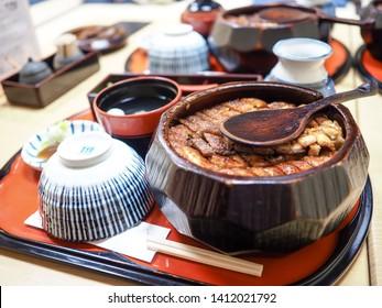 Japanese food Unagi Kabayaki Hitsumabushi style. Grilled Eel on rice served with miso soup