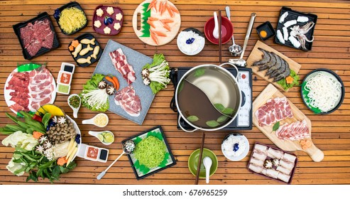 Japanese food,Sukiyaki,Overhead view of ingredients for shabu-shabu with some cooking in the broth.