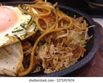 Japanese food,yakisoba and fried egg on top.