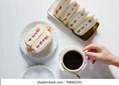 japanese fruit sandwich, fruit sando, mixed fruit sandwich with hot espresso coffee.