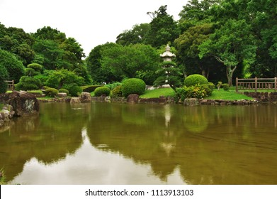"Japanese garden of The Akebono-yama Park. The plate in Japanese is written as ""main gate""."