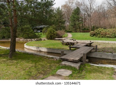 Japanese Garden of the Main Botanical Garden in Moscow. Spring landscape with a wooden bridge