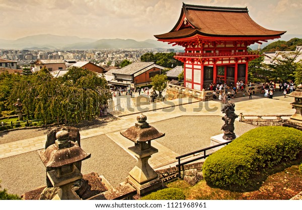 Japanese garden on a hill with a view of Kyoto in the background. Overview of the entrance gate of Kiyomizu-Dera Shrine in Kyoto.