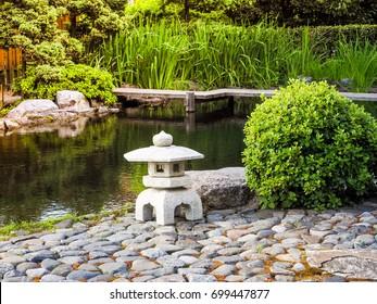 Japanese stone lanterns images stock photos vectors shutterstock japanese garden stone lantern placed near the pond in the japanese garden workwithnaturefo
