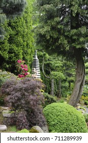Japanese garden in summer with a stone pagoda