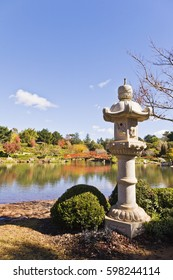 The Japanese Garden in Toowoomba, Queensland, Australia in autumn colours, with a Japanese style stone lantern.