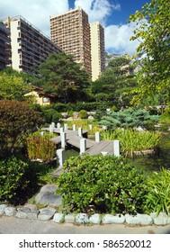 Japanese Garden walkway path Monte Carlo Monaco Europe condominium in background