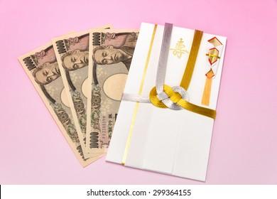 Japanese gift envelope and Ten thousand yen bill. Japanese traditional congratulation envelopes.