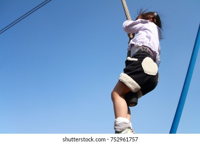 Japanese girl (3 years old) playing with flying fox