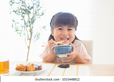 Japanese girl with a bowl