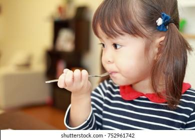 Japanese girl eating birthday cake (3 years old)