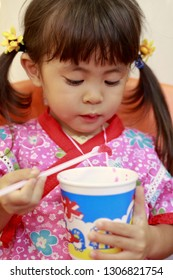 Japanese girl eating shaved ice in Yukata (3 years old)