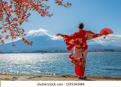Japanese girl with a fan on the background of the volcano of Fiji. The girl in the kimano.
