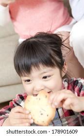 Japanese girl having cookies