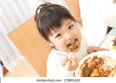 Japanese girl having curry rice