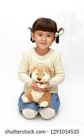 Japanese girl holding a stuffed rabbit (4 years old) (white back)