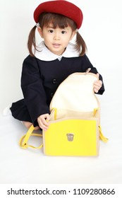 Japanese girl in kindergarten uniform (3 years old) (high angle) (white back)