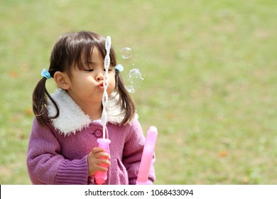 Japanese girl playing with bubble (3 years old)
