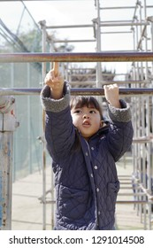 Japanese girl playing with a monkey bars (4 years old)