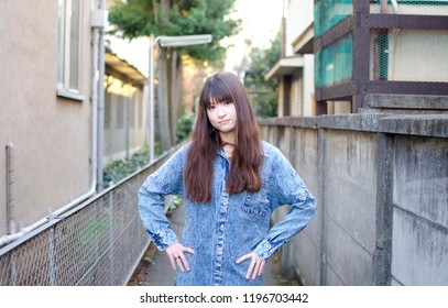 Japanese Girl poses on the street in Kichijoji, Japan. Kichijoji is a Tokyo's No.1 city people want to live.