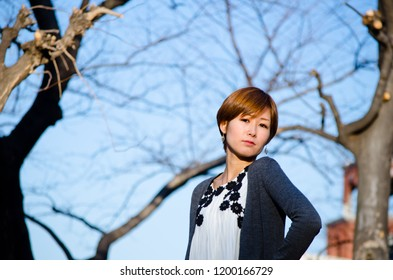 Japanese Girl poses on the street in Ebisu, Japan. Ebisu is an are located in Tokyo.