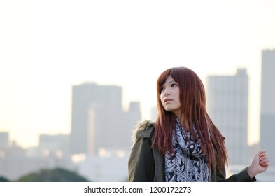 Japanese Girl poses on the street in Odaiba, Japan. Odaiba is a area by the sea in Tokyo.