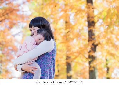 Japanese girl sleep is huggy to mother