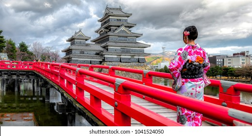 Japanese girl wearing traditional japanese kimono among Matsumoto Castle is one of the most complete and beautiful among Japan's original castles.