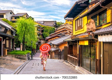 Japanese girl in Yukata with red umbrella in old town  Kyoto, Japan