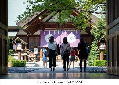 Japanese girls coming to pray at a temple for a good relationship in Tokyo.