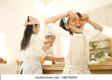 Japanese girls cooking in kitchen