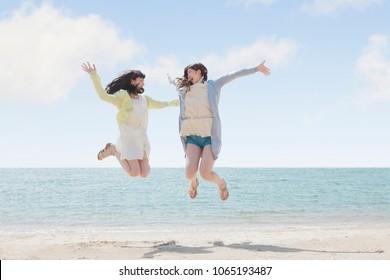 Japanese girls play on the beach
