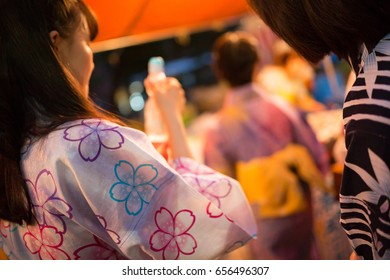 Japanese Girls at a Summer Festival in Tokyo.