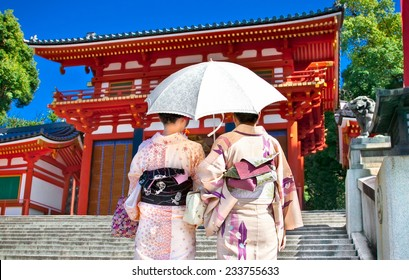 Japanese girls with Japanese traditional suit (Yukata) are walking in the Yasaka-jinja  shrine in Kyoto, Japan.