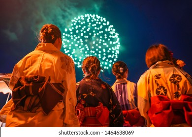Japanese girls wearing kimono are seen viewing Fireworks in Karatsu, Saga Prefecture. (Image is slightly soft)