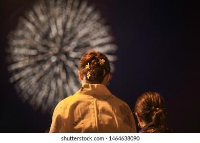 Japanese girls wearing kimono are seen viewing Fireworks in Karatsu, Saga Prefecture. (Image is slightly soft)