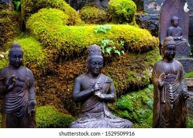 Japanese gods statue in mitakidera temple garden, Hiroshima
