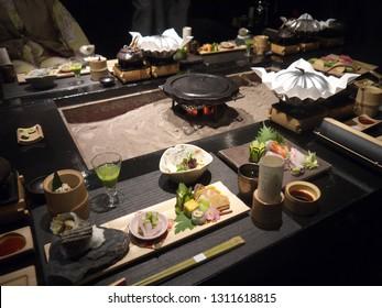 Japanese gourmet kaiseki diner with traditional irori fireplace