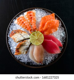 Japanese gourmet sashimi, raw sliced fish, shellfish or crustaceans, Salmon, tuna sashimi, eel on ice pillow. Premium Tai fish Ebi sashimi, Maguro sashimi