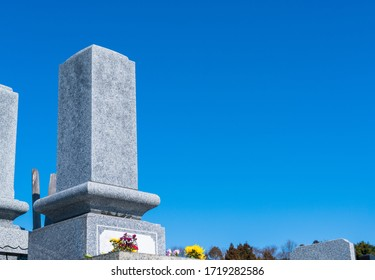 A Japanese grave and a beautiful blue sky.