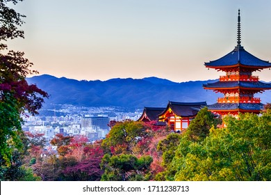 Japanese Heritage. Renowned Kiyomizu-dera Temple Pagoda Against Kyoto Skyline  and Traditional Red Maple Trees in Background in Japan. Horizontal Image