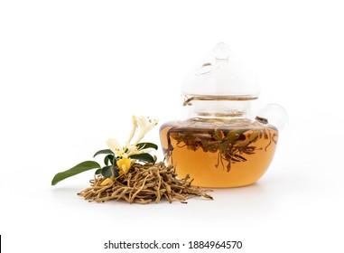 Japanese Honeysuckle or Honeysuckle flowers and tea isolated on white background.