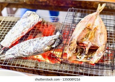 Japanese Horse Mackerel or Aji on Grill with Flame