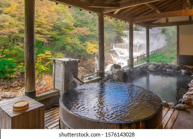 Japanese Hot Springs Onsen Natural Bath Surrounded by red-yellow leaves. In fall leaves fall in Fukushima, Japan.