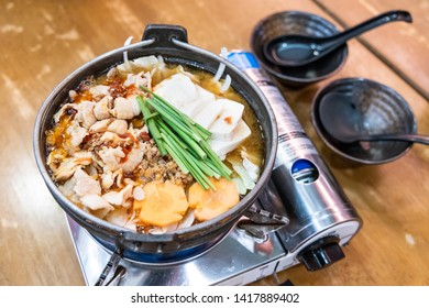 Japanese hotpot buta akakara nabe with pork and spicy soup in restaurant