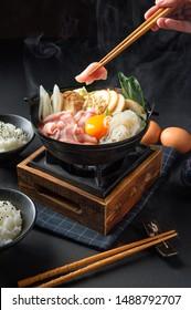 Japanese hotpot buta akakara nabe with pork rice set . In lighting studio .