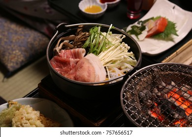 Japanese hotpot, the Japanese traditional style hotpot with pork belly, vegetable and wild mushroom serve in Japanese set menu. The dinner set for traveler in the hot spring resort in Japan.